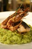 Close up of grilled prawn and salmon risotto