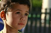 A young boy engrossed in his play, outdoor with beautiful evening sun lighting