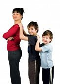 An asian mom with her two boys of mix parentage, playing trains. Concept : Family value