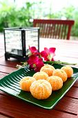 stock photo of satsuma  - A plate of peeled satsumas served in a plate - JPG