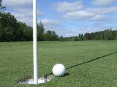 Golf Ball On Lip Of Hole