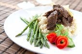 Delicious lamb cous cous with grilled asparagus
