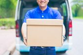 Delivery Concept - Smiling Happy Young Asian Handsome Male Postal Delivery Courier Man In Front Of C poster