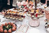 Luxury Wedding Catering, Table With Modern Desserts, Cupcakes, Sweets With Fruits. Delicious Candy B poster