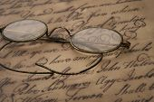 picture of bifocals  - Old glasses on the vintage document - JPG