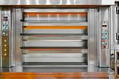 stock photo of bakeshop  - Bakery baking machine oven with four levels - JPG