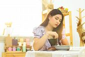 Lonely Asian Woman Sit At The Table Eating Meal In The Kitchen Alone In The Morning With Beautiful S poster
