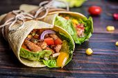 Traditional Mexican Tortilla Wrap With Vegetables And Grilled Chicken Meat On Dark Wood Table poster