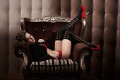 Luxury fashion woman in the chair