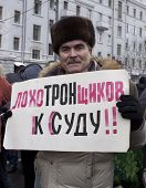 Russia, Moscow - December 24: Man With Poster Call For Court For Russian Election Committee