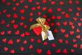 Gift boxes on wooden table. Gift image suitable for Valentines Day, Christmas, New Year or Birthday. poster