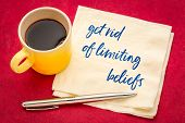 get rid of limiting beliefs concept - handwriting on a napkin with a cup of coffee poster