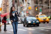 Young Asian professional woman walking home commuting from work in New York city street. Urban peopl poster