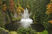 Magnificent dance fountain in well-known Butchard-garden on island Vancouver poster