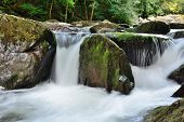 Long Exposure Of A Waterfall At Watersmeet In Devon poster