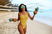 Incredibly Beautiful Sexy Girl Models In A Bikini On The Sea Shore Of A Tropical Island Pineapple, B poster