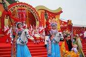 HONG KONG - JANUARY 24:  Beautiful dancers on stilts represent horsemen. Park Ocean. January 24, 200