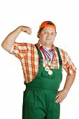 image of roustabouts  - Young worker in green overalls flexing its muscles - JPG