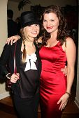LOS ANGELES - DEC 17:  Tamara Braun, Heather Tom at the 2011 Tom / Achor Annual Christmas Party at Private Home on December 17, 2011 in Glendale, CA