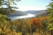 overlook of reservoir lake and leaves changing color in the Allegheny National Forest in fall