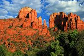 Catheral Rock Sedona Arizona Located In Red Rock Country With Beautiful Cloud Formations And Blue Sk poster