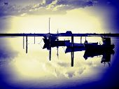 stock photo of dory  - Reflection of a small dinghy dory boats in the sunset great sailing boating fishing image digital art manipulation - JPG