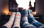 Cozy Woolen Socks. Couple Watching Tv In Winter. Man And Woman Using Online Streaming Service For Mo poster
