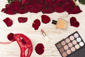 Romantic Carnival Concept. Red Carnival Mask, Bouquet Of Red Roses, Lipstick, Bottle Of Perfume And  poster