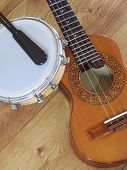 Two Brazilian Musical Instruments: Cavaquinho And Tamborim With Drumstick On A Wooden Surface. They  poster