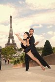 Dance Couple In Front Of Eifel Tower In Paris, France. Beatuiful Ballroom Dance Couple In Dance Pose poster