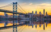 Philadelphia Sunset Skyline And Ben Franklin Bridge Refection From Across The Delaware River poster