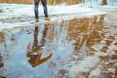 Melting Snow. Big Puddle. Man Trying To Pass Through. Spring Is Coming poster