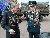 MOSCOW - MAY 9: Two veterans talking on Victory Day (65th anniversary) in the Great Patriotic War celebrations in Park Kultury, May 9, 2010 in Moscow, Russia.