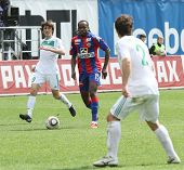 MOSCOW - MAY 10: CSKA's Chidi Odiah (C) in action during their team's Russian football championship