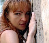 Girl Near Stones Wall