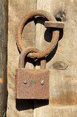 Rusty Lock On The Wooden Door