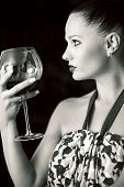 The Girl Is Holding In His Hand A Glass Of  Red Wine