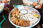stock photo of yangon  - Varieties of Burmese dessert sell in a market in Yangon - JPG
