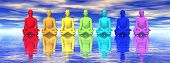 foto of tantra  - Seven human with chakra colors meditating in blue background - JPG