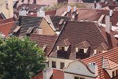 stock photo of gabled dormer window  - Roofs of houses from a red tiles - JPG