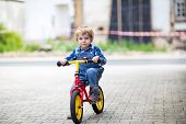 3 Years Old Toddler Riding On His First Bike