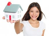 Home / house. Buying new home concept - woman holding mini house. House mortgage and happy home owne