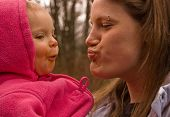 picture of niece  - A fun candid moment with young adult aunt with her baby girl niece making silly faces at each other while enjoying this family together time - JPG