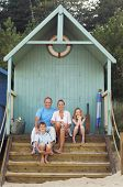 Portrait of a vacationing Family sitting together in beach hut