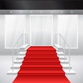 Entry to shop with stairs, windows and red carpet