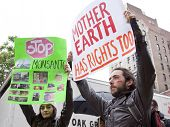 NEW YORK-MAY 25: A protestor holds a sign that says 'Mother Earth Has Rights Too' at the March Again