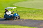 picture of caddy  - Golf cart or club car at golf course - JPG