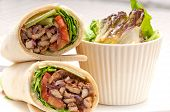 stock photo of pita  - kafta shawarma chicken pita wrap roll sandwich traditional arab mid east food - JPG