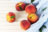Peaches on napkin on wooden table
