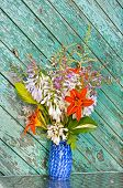 Still Life Bouguet Hosta, Astilbe And Hemerocallis In Blue Vase